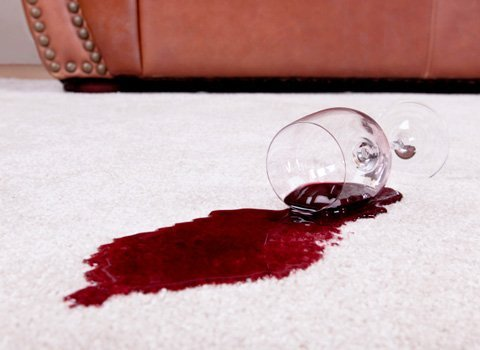Wine spill causes staining on carpet